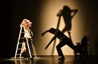 photo of a female dancer on a white ladder
