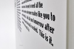 image of text art, photographed from an oblique slant
