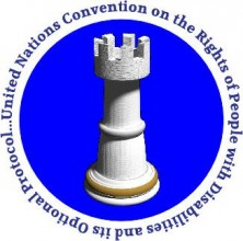 shows an image of a chess piece - a castle - with lettering around the circumference of the round central image