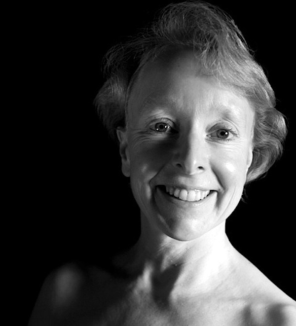 black and white headshot of poet clare best, smiling