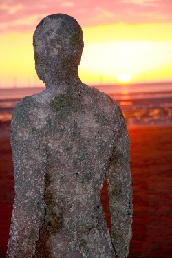 photograph of Anthony Gormley's iron man from a sculptural placement at Crosby Beach in Merseyside
