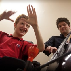 photo of two young disabled musicians