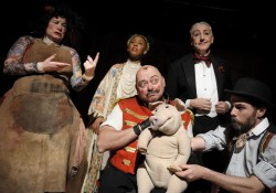 photo of the cast from the show centred around the puppet, edmund the learned pig