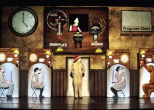 the cast of five actors from the company 1927 lined up with an animated projection behind them