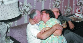 photo of elderly couple kissing