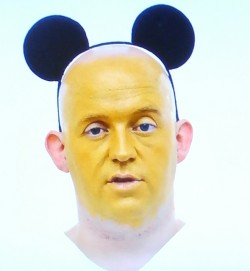 photo of artist David Beaumont wearing mickey mouse ears against a white background