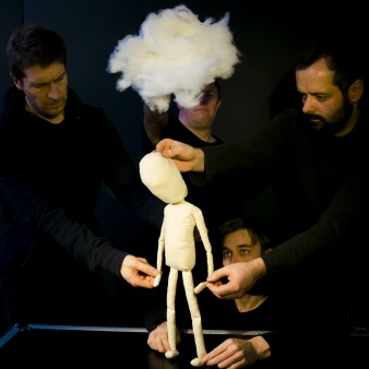A production shot from Hijinx's Meet Fred. A cloth puppet is being held by four puppeteers (Dan McGowan, Morgan Thomas Craig Quat and Martin Vick). A cloud is held above the puppet's head.