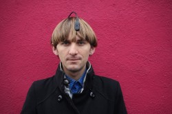 portrait photo of musician Neil Harbisson wearing his