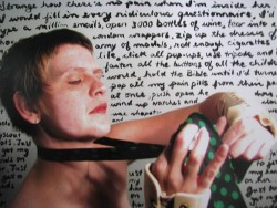 A photograph of multi-disciplinary artist Sandra Alland. She is wearing a tie and wrist supports and is against a backdrop of handwritten words.