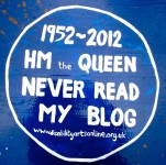 blue plaque reading HM The Queen Never Read My Blog