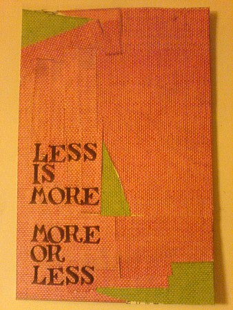 a woven orange canvas withan orange canvas with the words 'less is more, more or less' woven into itthe words 'less is more, more or less' woven into the fabric