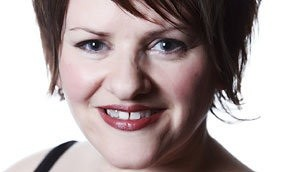 photo of face of dancer Caroline Bowditch, smiling at the camera