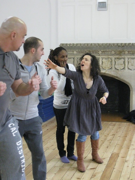 photo of three deaf actors in rehearsal being directed by Paula Garfield