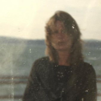 a blurred photograph of poet Maggie Sawkins