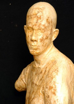 Clay sculpture of a male figure