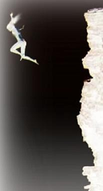 black image of an edge with a figure falling