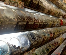 photo of rows of glass jars full of glass marbles with exotic names