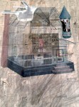 Photo of a newspaper collage behind a wire mesh house