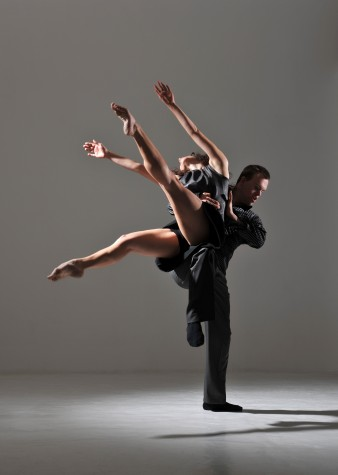 a male and a female dancer against a grey background