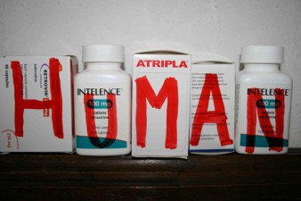 five medication bottles with the word human spelt on each container Vince Laws