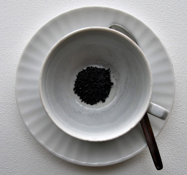 Cup, saucer, spoon.